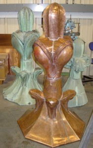 We hand formed copper finials to replicate originals (in the background) as well as restoring existing ones that were salvageable.