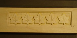 Hand carved leaf cross arm pattern