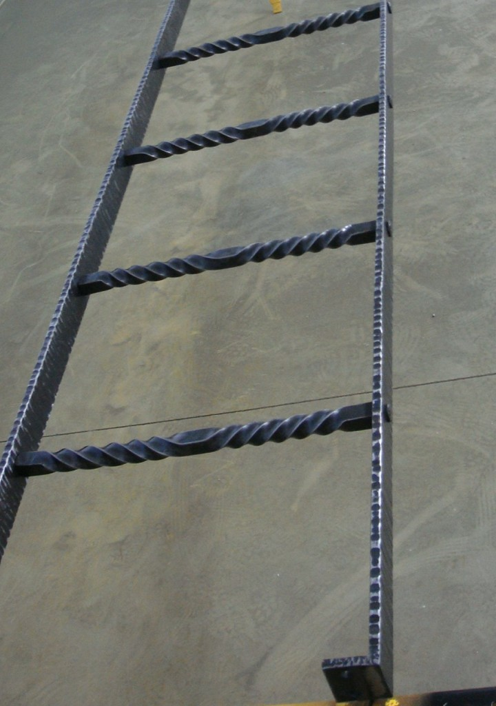Hand Forged Iron Ladder With A Hammer Textured Finish