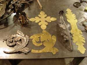Repoussed leaves start off as flat pieces of bronze, then hand hammered to form desired form.