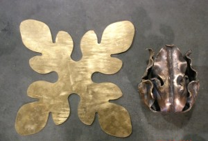 This flower started out life as a flat piece of bronze sheet metal. The piece was formed into it's beautiful final state by the art of repousse (a method of creating a relief design by hammering the back side of the metal).
