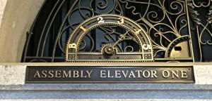 Fabricated bronze Elevator Signage with cast bronze floor indicators